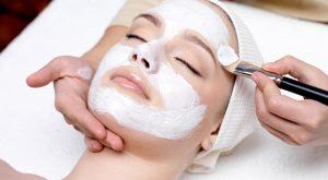 Woman Receiving an Eminence Facial Therapy